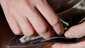 Businessman hands counting dollar bills in his wallet. UltraHD video stock video footage