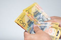 Businessman hands counting fifty Australian Dollar bills isolate Royalty Free Stock Image