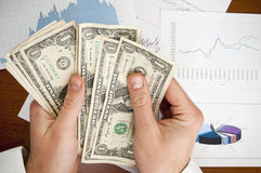 Businessman hands counting money Stock Photos