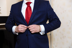 Businessman hands with cufflinks and clocks. Elegant gentleman clother Royalty Free Stock Photo