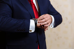Businessman hands with cufflinks and clocks. Elegant gentleman clother Stock Image