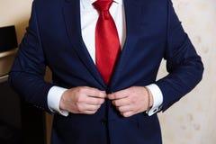 Businessman hands with cufflinks and clocks. Elegant gentleman clother Stock Image