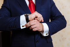 Businessman hands with cufflinks and clocks. Elegant gentleman clother Royalty Free Stock Images