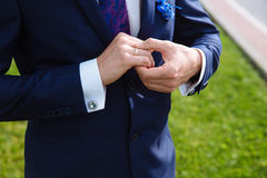 Businessman hands with cufflinks. Elegant gentleman clother Royalty Free Stock Image