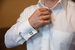 Businessman hands with cufflinks. Elegant gentleman clother Stock Image