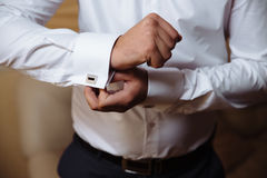 Businessman hands with cufflinks. Elegant gentleman clother Royalty Free Stock Images