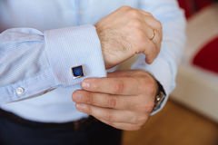 Businessman hands with cufflinks. Elegant gentleman clother Stock Images