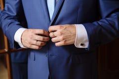 Businessman hands with cufflinks. Elegant gentleman clother Royalty Free Stock Image