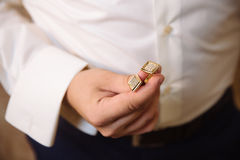 Businessman hands with cufflinks. Elegant gentleman clother Stock Images