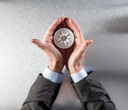 Businessman hands displaying a compass in his palms for idea Stock Photography