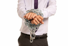 Businessman hands fettered chain padlock job slave. Businessman hands fettered with chain and padlock, job slave symbol, isolated on white background Stock Photography