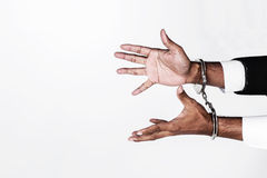 Businessman hands fettered with handcuffs isolated on white with Royalty Free Stock Photo