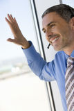 Businessman with hands-free telephone headset Stock Image