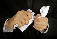Businessman hands furiously tormenting document stock photography