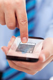 Businessman hands with futuristic smartphone Stock Photos