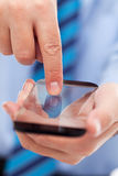 Businessman hands with futuristic smartphone Stock Images