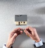 Businessman hands giving home key to manage the exchange Stock Image