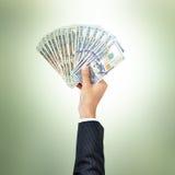 Businessman hands giving money,US dollar (USD) bills Stock Images
