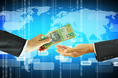 Businessman hands giving & receiving money - Australian dollars Royalty Free Stock Photo