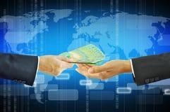 Businessman hands giving & receiving money - Australian dollars Stock Photography