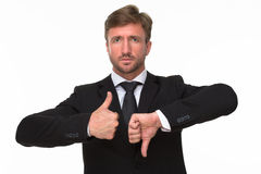 Businessman' hands giving a thumbs up and down Stock Photos