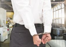Businessman hands in handcuffs Stock Photography