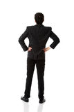 Businessman with hands on hips. Stock Photos