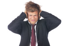 Businessman with hands on his ears Royalty Free Stock Photography