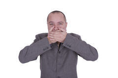 Businessman with hands on his mouths Stock Photos