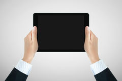Businessman hands hoilding tablet pc with empty screen Stock Photo
