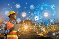 Free Businessman Hands Hold Tablet Working With Night Oil Refinery Industry Plant And Industry Icons. Factory In The Night As Royalty Free Stock Photography - 185360747
