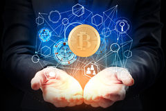 Cryptocurrency concept. Businessman hands holding abstract bitcoin hologram on dark background. Cryptocurrency concept royalty free stock photos