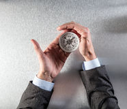Businessman hands holding a compass, managing his career orientation Stock Photo