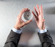 Businessman hands holding compass, searching for corporate idea or orientation Royalty Free Stock Photography