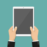 Businessman hands holding tablet with blank screen in a flat design Stock Image