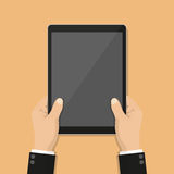 Businessman hands holding tablet with blank screen in a flat design Stock Photos