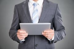 Businessman hands holding tablet computer Royalty Free Stock Image