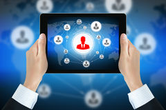Businessman hands holding tablet pc with businesspeople icon network on screen Royalty Free Stock Images