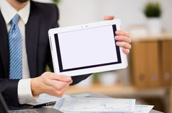 Businessman hands are holding the touch screen Stock Photography