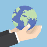 Businessman hands holding the world Stock Images