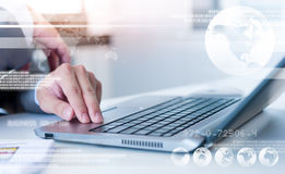 Businessman hands on laptop with technology layer effect, Busine Stock Images