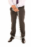 Businessman hands and legs chain, job slave symbol Royalty Free Stock Image