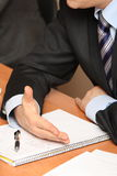 Businessman hands and notepad Stock Image