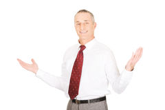 Businessman with hands open in undecided gesture Stock Photo