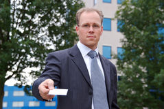 Businessman hands over an empty businesscard Stock Images