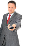 Businessman hands over phone Royalty Free Stock Images