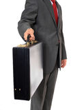 Businessman hands over suitcase Stock Images