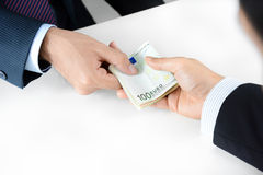 Businessman hands passing money, Euro currency (EUR) Royalty Free Stock Images