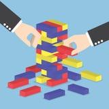 Businessman hands play wood block tower game Stock Photos