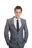 Businessman with hands in pockets Stock Photos